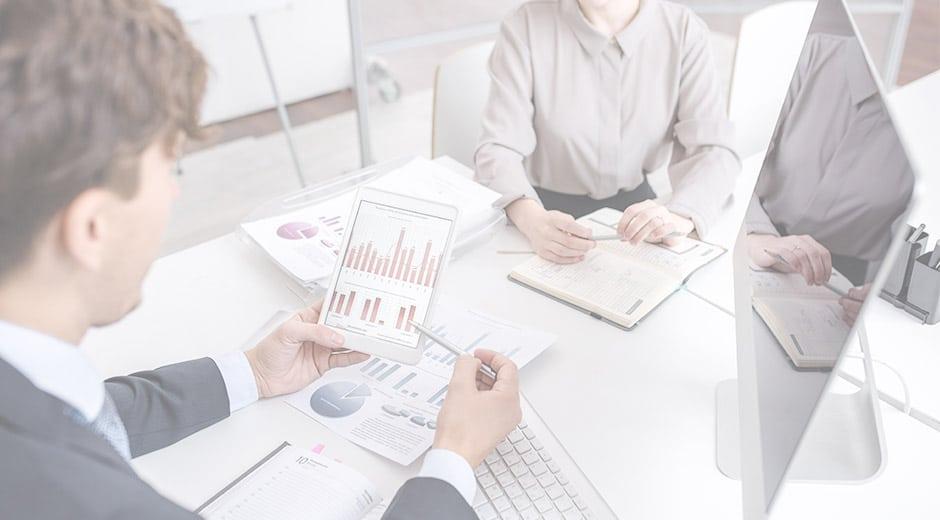 Logistics team reviewing data analytics